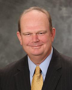Walt Huggins : Executive Vice President and Member